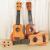 ギターの児童玩具音楽器ウクレ音楽早教啓蒙益智玩具ベビー玩具中号43.5 cm桃心ギター赤木色