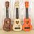 ギターの児童のおもちゃの楽器のウクレ音楽は早く啓発して益智のおもちゃの赤ちゃんのおもちゃのトランペットの38.5センチメートルの赤い木の色を教えます。